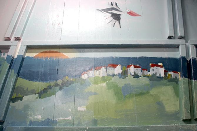 detalle monte y puesta de sol del mural aita mari